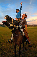 "Rupert Issacson, a campaigning writer and former horse trainer, sits with his five-year-old autistic son, Rowan, on a horse during an expedition across Mongolia. Rowan, who has been nicknamed ""The Horse Boy"", embarked on a therapeutic journey of discovery with his parents to visit a succession of shaman healers in one of the most remote regions in the world. Following Rowan's positive response to a neighbour's horse, Betsy, and some reaction to treatment by healers, Rowan's parents hoped that the Mongolian shamanistic rituals along the route and the prolonged contact with horses would help to unlock their son's autism and assist his development.."