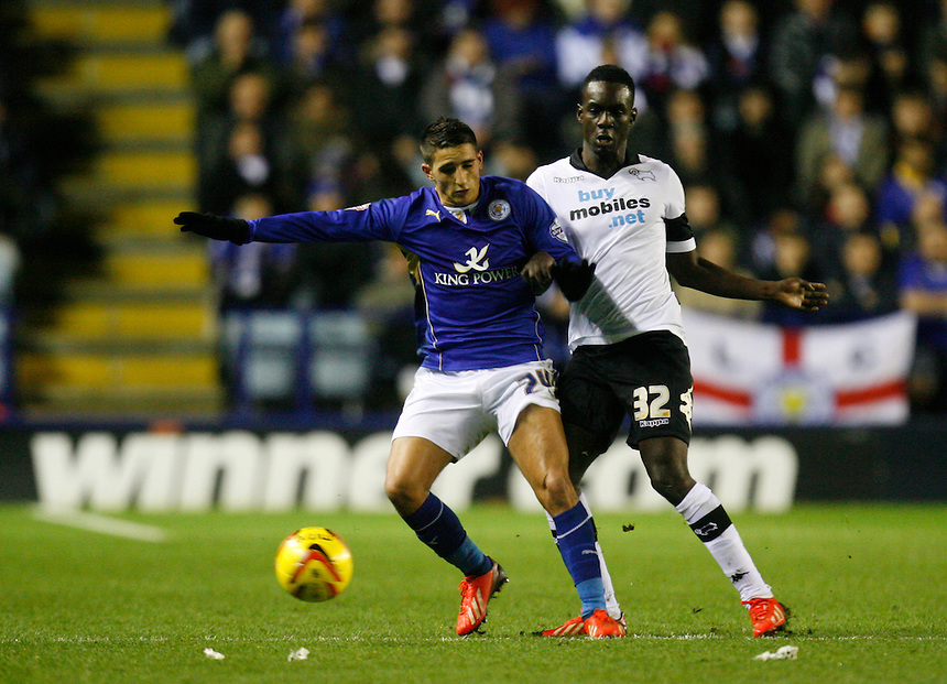 Leicester City's Anthony Knockaert (L) and Derby County's Simon Dawkins in action during todays match  <br /> <br /> Photo by Jack Phillips/CameraSport<br /> <br /> Football - The Football League Sky Bet Championship - Leicester City v Derby County - Friday 10th January 2014 - King Power Stadium - Leicester<br /> <br /> &copy; CameraSport - 43 Linden Ave. Countesthorpe. Leicester. England. LE8 5PG - Tel: +44 (0) 116 277 4147 - admin@camerasport.com - www.camerasport.com