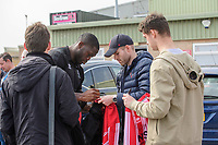 Lincoln City's John Akinde signs autographs for fans after arriving at the ground<br /> <br /> Photographer Chris Vaughan/CameraSport<br /> <br /> The EFL Sky Bet League Two - Lincoln City v Macclesfield Town - Saturday 30th March 2019 - Sincil Bank - Lincoln<br /> <br /> World Copyright © 2019 CameraSport. All rights reserved. 43 Linden Ave. Countesthorpe. Leicester. England. LE8 5PG - Tel: +44 (0) 116 277 4147 - admin@camerasport.com - www.camerasport.com