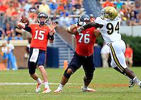 Virginia quarterback Matt Johns (15) Virginia offensive tackle Michael Mooney (76) during the game in Charlottesville, VA. Virginia lost to UCLA 28-20. Photo/Andrew Shurtleff