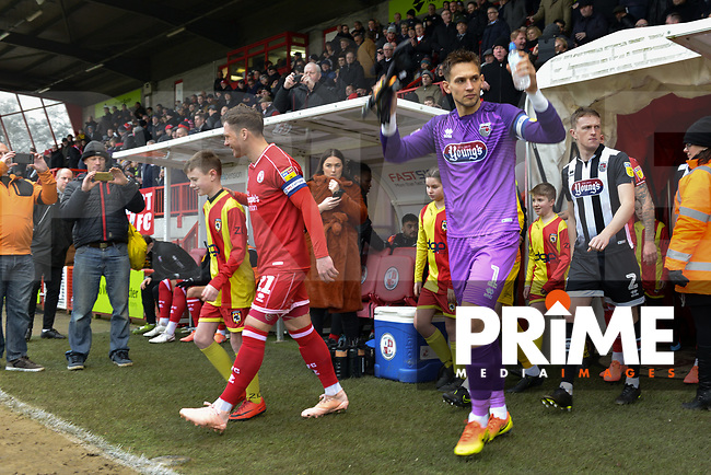 James McKeown leads the players out of the tunnel during the Sky Bet League 2 match between Crawley Town and Grimsby Town at The People's Pension Stadium, Crawley, England on 25 January 2020. Photo by Lee Blease.