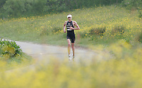 09 JUN 2007 - TREDEGAR, UK - Julie Dibens settles into a comfortable stride during the run, on her way to winning the womens title at the National Elite Triathlon Championships which were held as part of the second round of the Corus Elite Triathlon Series. (PHOTO (C) NIGEL FARROW)