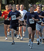 Washington, DC - June 22, 2002 -- United States President George W. Bush participates in a 5K run as part of the President's Fitness Challenge at Fort McNair in Washington on 22 June, 2002.<br /> Credit: Ron Sachs / Pool via CNP