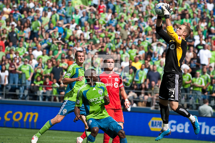 Teammate Jim Brennan (2R) watches as Stefan Frei (R) of Toronto FC goes up high for a save against Nate Jaqua (L) and Jhon Kennedy Hurtado (2L) of the Seattle Sounders in the match at the XBox Pitch at Quest Field on August 29, 2009. The Sounders and Toronto played to a 0-0 draw.