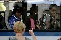 Roma, 7 Giugno 2016<br /> Migranti su un autobus della polizia.<br /> Operazioni di controllo tra i rifugiati della tendopoli sorta spontanea in Via Tiburtina e in via Cupa dove c'era il centro di accoglienza Baobab