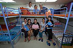 Domestic workers in Hong Kong pose for a photo in a shelter run by Bethune House. The ministry supports women who have suffered abuse or have other problems with their employment.  <br /> <br /> There are about 370,000 foreign domestic workers in Hong Kong–about 5 percent of the population–almost all from Indonesia and the Philippines. More than 98 percent of the workers are women, most of whom leave their families behind so that they can earn money to help their families survive.