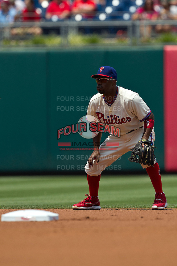 Philadelphia Phillies shortstop Jimmy Rollins #11 on defense during the Major League Baseball game against the Pittsburgh Pirates on June 28, 2012 at Citizens Bank Park in Philadelphia, Pennsylvania. The Pirates defeated the Phillies 5-4. (Andrew Woolley/Four Seam Images).