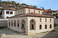 The Helveti Tekke or Teqe e Helvetive, a Bektashi Sufi shrine of the Helveti sect built in the 15th century and rebuilt by Ahmet Kurt Pasha in 1782, in Berat, South-Central Albania, capital of the District of Berat and the County of Berat. It is composed of a square prayer hall, an external portico (with columns from Appolonia) and a room which housed the mausoleum of Ahmet Kurt Pasha and his son. On the inner walls are 8 frescoes of houses, muslim religious buildings and gardens. Picture by Manuel Cohen