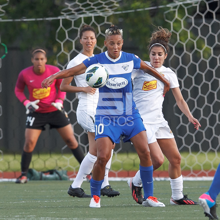 Boston Breakers forward Lianne Sanderson (10) collects a pass and fends off Western New York Flash midfielder Angela Salem (6). In a National Women's Soccer League Elite (NWSL) match, the Boston Breakers (blue) tied Western New York Flash (white), 2-2, at Dilboy Stadium on June 5, 2013.