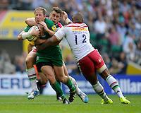 David Paice of London Irish is tackled by Nick Easter and Jordan Turner-Hall of Harlequins during the Premiership Rugby Round 1 match between London Irish and Harlequins at Twickenham Stadium on Saturday 6th September 2014 (Photo by Rob Munro)