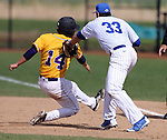 BROOKINGS, SD - MAY 9: Aaron Machbitz #33 for South Dakota State puts the tag on Neil DeCook #14 from Western Illinois  on a pick off Friday afternoon in Brookings. (Photo by Dave Eggen/Inertia)