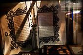 Sarajevo 09.12.2009 Bosnia and Herzegovina<br /> Koran on shop-window.Bosnia and Herzegovina for many years dreamed to be adopted into the European Union. On the streets, everybody can see young and old people who looks like Europeans. Streets in the city center are also similar to European cities. Unfortunately, all people in BiH know that political disagreement between warring nationalities in the parliament does not help them to be accepted into the EU.<br /> Photo: Adam Lach / Newsweek Polska / Napo Images<br /> <br /> Koran na witrynie sklepowej.<br /> BiH od wielu lat marzy by przyjeto ja do UE. NA ulicach widac mlodych i starszych ludzi ktory wygladaja jak europejczycy. Ulice w centrum miasta sa rownie podobne do miast europejskich. Niestety wewnetrznie wszyscy wiedza ze polityczna niezgoda pomiedzy zwasnionymi narodowosciami w parlamencie nie pomaga im na to bby przystapic do UE.<br /> Photo: Adam Lach /  Newsweek Polska / Napo Images