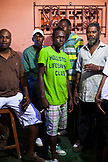 JAMAICA, Port Antonio. Locals drinking at the Boundbrook Bar.
