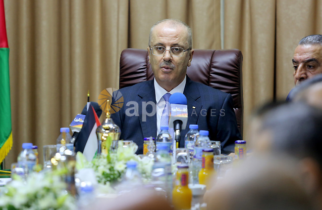 Palestinian Prime Minister Rami Hamdallah chairs a reconciliation government cabinet meeting in Gaza City on October 3, 2017. The Palestinian reconciliation government met in Gaza for the first time since 2014 as moves intensify to end the decade-old rift between the main political factions. Photo by Atia Darwish