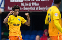 Sido Jombati of Wycombe Wanderers makes a point to teammates after scoring his free kick during the Sky Bet League 2 match between Portsmouth and Wycombe Wanderers at Fratton Park, Portsmouth, England on 23 April 2016. Photo by Andy Rowland.
