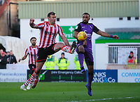 Lincoln City's Matt Rhead vies for possession with Port Vale's Leon Legge<br /> <br /> Photographer Chris Vaughan/CameraSport<br /> <br /> The EFL Sky Bet League Two - Lincoln City v Port Vale - Tuesday 1st January 2019 - Sincil Bank - Lincoln<br /> <br /> World Copyright © 2019 CameraSport. All rights reserved. 43 Linden Ave. Countesthorpe. Leicester. England. LE8 5PG - Tel: +44 (0) 116 277 4147 - admin@camerasport.com - www.camerasport.com