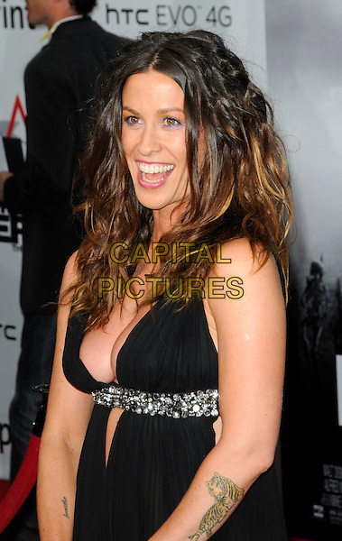 "ALANIS MORISSETTE.The Hollywood Premiere ""Prince Of Persia: The Sands Of Time"" at Grauman's Chinese Theatre in Hollywood, California, USA..May 17th, 2010.half length dress black low cut out cleavage sleeveless plunging neckline silver waist strap mouth open tattoos tiger breathe .CAP/ROT.©Lee Roth/Capital Pictures"