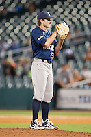 Rice Owls relief pitcher Kevin McCanna #23 looks to his catcher for the sign against the Texas Longhorns at Minute Maid Park on February 28, 2014 in Houston, Texas.  The Longhorns defeated the Owls 2-0.  (Brian Westerholt/Four Seam Images)