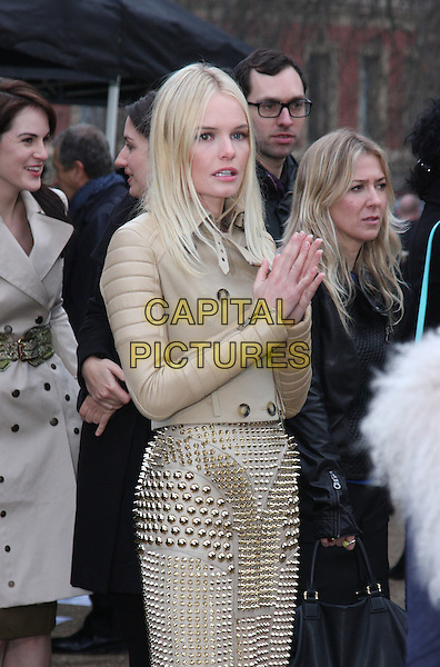 KATE BOSWORTH.The Burberry Prorsum Fashion Show during London Fashion Week Autumn/Winter 2011, Kensington Gardens, London, England..21st February 2011.LFW half length jacket hands together praying skirt studs studded beige leather .CAP/ROS.©Steve Ross/Capital Pictures
