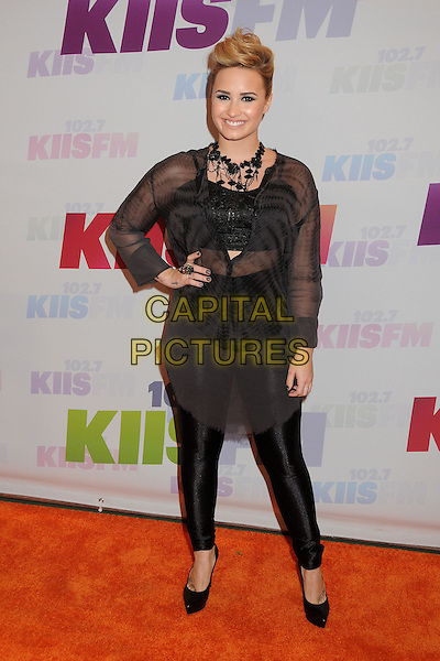 Demi Lovato.at KIIS FM's Wango Tango 2013 held at The Home Depot Center, Carson, California, USA, 11th May 2013..arrivals  full length black sheer see thru through shirt top leggings hand on hip shoes necklace .CAP/ADM/BP.©Byron Purvis/AdMedia/Capital Pictures