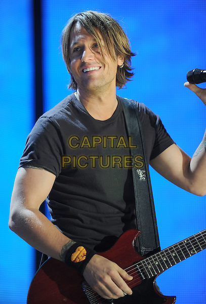 KEITH URBAN.2008 CMA Music Festival Nightly Concert held on Vault Concert Stage at LP Field, Nashville, Tennessee, USA..June 6th, 2008.stage concert live gig performance music half length black t-shirt guitar .CAP/ADM/LF.©Laura Farr/AdMedia/Capital Pictures.