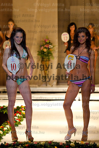 Klaudia Bernath (left) and Bianka Dezsanyi (right) attends the Miss Hungary 2010 beauty contest held in Budapest, Hungary on November 29, 2010. ATTILA VOLGYI