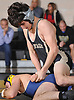 Ben Rogers, top, battles Matt Brams of Bethpage at 126 pounds during a Nassau County varsity wrestling match at Wantagh High School on Wednesday, Dec. 19, 2018. Rogers won the match by pin.