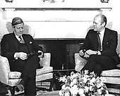 United States President Gerald R. Ford and Chancellor Helmut Schmidt of Germany meet in the Oval Office of the White House in Washington, DC following the arrival ceremony on the South Lawn on December 5, 1974.  Schmidt is scheduled to speak with the President about the oil problem and the economy.  Helmut Schmidt passed away on November 10, 2015 at age 96.<br /> Credit: Barry Soorenko / CNP