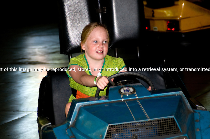 Young girl having fun in bumper car