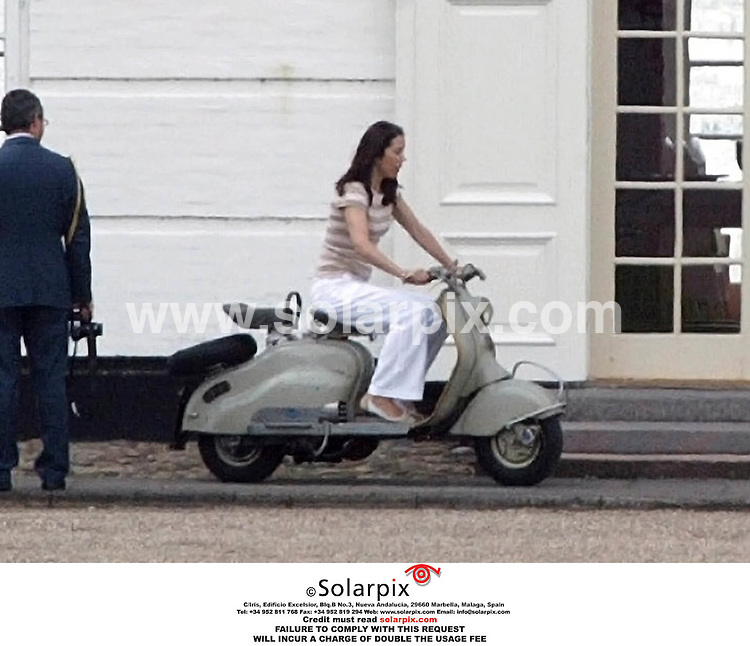 ALL ROUND PICTURES BY SOLARPIX.COM.Last week the Danish royal family had their annual reunion at Graasten Castle. This tradition was started by the late Queen Mother Ingrid, and now Queen Margrethe, being a grandmother herself, continues the yearly event. During the stay Crown Princes Mary took Crown Prince Frederik for a ride on a vespa scooter. JOB REF:2702-DNA. 02.08.06.MUST CREDIT SOLARPIX.COM OR DOUBLE FEE WILL BE CHARGED.....