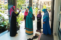 January 10, 2015 - Rawang (Malaysia). Dr. Azlina Jamaluddin (left) talks with some friends. She works as a dentist at the Global Ikhwan Clinic in Rawang and she was one of the Obedient Wives Club Organiser. Educated in Australia she joined the company in 2001. © Thomas Cristofoletti / Ruom
