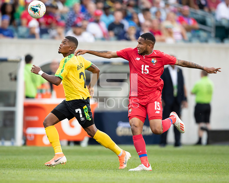 PHILADELPHIA, PA - JUNE 30: Leon Bailey #7 and Eric Davis #15 vie for the ball during a game between Panama and Jamaica at Lincoln Financial FIeld on June 30, 2019 in Philadelphia, Pennsylvania.
