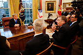 United States Trade Representative Robert Lighthizer confers with Liu He, Vice Premier of the People's Republic of China, as US President Donald J. Trump looks on in the Oval Office of the White House, in Washington, DC, February 22, 2019.  Also pictured at right is US Secretary of Commerce Wilbur L. Ross, Jr. and US Secretary of the Treasury Steven T. Mnunchin.<br /> Credit: Martin H. Simon / CNP