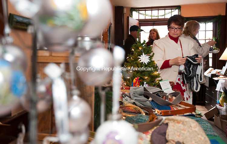 WOODBURY CT--- -112215JS09-Paula Price of Bethlehem, right, looks over times for sale during the third annual Artisan Marketplace Sunday at Flanders Nature Center in Woodbury. The marketplace will take place every Saturday and Sunday from 11am to 4pm though the holidays. <br /> Jim Shannon Republican-American