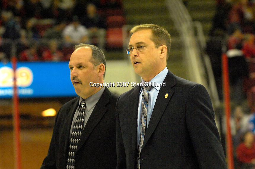 Toronto Maple Leafs' head coach Paul Maurice, right, walks off the ice with assistant coach Randy Ladoceur at intermission during a hockey game with the Carolina Hurricanes Tuesday, Jan. 30, 2007 at the RBC Center in Raleigh. The Leafs won 4-1.