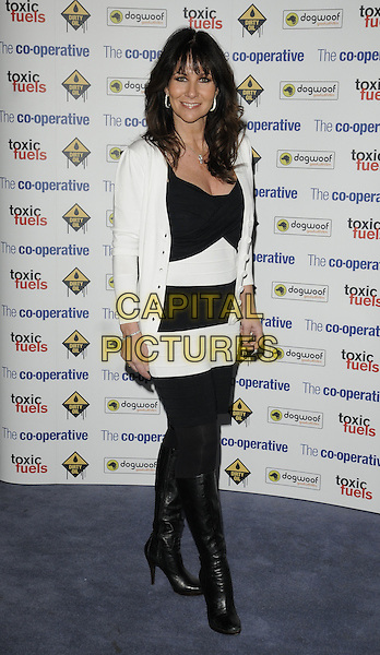 "LINDA LUSARDI.The film premiere of ""Dirty Oil"", Barbican Centre, London, England.March 15th 2010.full length black white striped stripes  dress tights cardigan knee high boots velvet .CAP/CAN.©Can Nguyen/Capital Pictures."