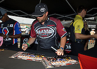 Jul. 26, 2013; Sonoma, CA, USA: NHRA top fuel dragster driver Shawn Langdon signing autographs during qualifying for the Sonoma Nationals at Sonoma Raceway. Mandatory Credit: Mark J. Rebilas-