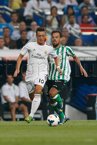 18.08.2013. Madrid, Spain, La Liga football  Real Madrid CF versus  Real Betis Balompie (2-1) at Santiago Bernabeu stadium. The picture shows Mesut Ozil (German midfielder of Real Madrid)
