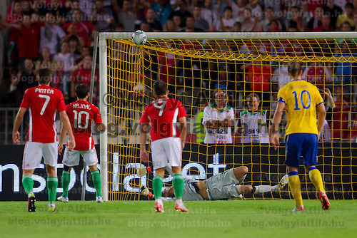 Hungary's Adam Pinter (L), Tamas Hajnal (2nd L) and Imre Szabics (3rd L) with Sweden's Zlatan Ibrahimovic (R) watch as Sweden's goalkeeper Andreas Isaksson (back C) tries to save a faulty goal during the UEFA EURO 2012 Group E qualifier Hungary playing against Sweden in Budapest, Hungary on September 02, 2011. ATTILA VOLGYI