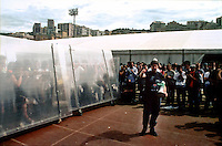 "genova luglio 2001, proteste contro il g8. allo stadio carlini, test di resistenza delle barricate con luca casarini, leader delle tute bianche --- genoa july 2001, protests against g8 summit. at the carlini stadium, toughness test of the barricades with luca casarini, leader of the ""tute bianche"" (white overalls)"