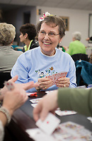NWA Democrat-Gazette/CHARLIE KAIJO Ellie Wood of Bella Vista plays cards during a charity card party, Friday, March 15, 2019 at the Bella Vista Community Church in Bella Vista. <br /><br />The Bella Vista Garden Club held a card party - groups of four purchased a table and brought card games to play. The Garden Club and volunteers provided food. Proceeds for the event went to scholarships for horticulture students. Last year they gave two $4,000 scholarships to veterans. Over 200 people attended the event. Merchants donated over $2,000 in raffle basket prizes. <br /><br />&quot;When I opened to take reservations over 75 percent of the tables were filled in a day,&quot; said Carol Tabat, garden club member.