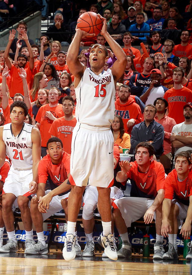 Virginia guard Malcolm Brogdon (15) shoots a 3-point play during the second half of an NCAA basketball game against Louisville Saturday Feb. 7, 2015, in Charlottesville, Va. Virginia defeated Louisville  52-47. (Photo/Andrew Shurtleff)