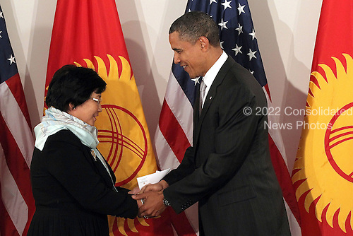 United States President Barack Obama shakes hands at a bilateral meeting with President of Kyrgyzstan Rosa Otunbaeva on Friday, September 24, 2010 in New York City. Obama has been in New York since Wednesday attending the annual General Assembly at the United Nations where in a speech yesterday he stressed the need for a resolution between Israel and Palestine a renewed international effort to keep Iran from attaining nuclear weapons. .Credit: Spencer Platt - Pool via CNP
