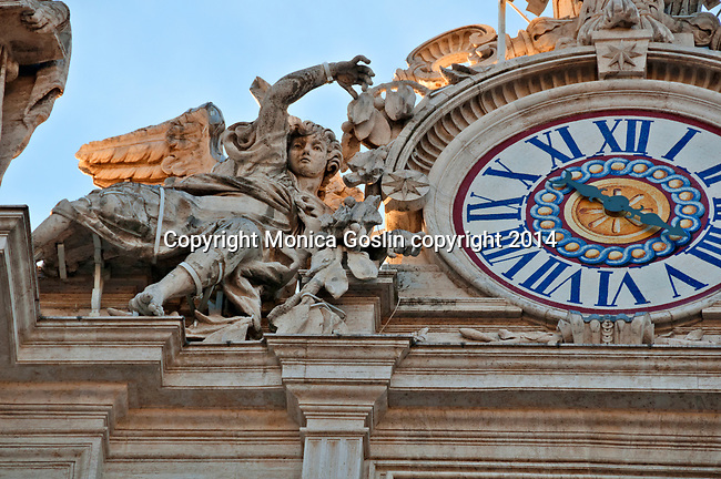 Detail of statues and a clock on the outside of St. Peter's Basilica