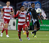 Santa Clara, California - Saturday July 18, 2012: FC Dallas' Julian de Guzman fights for the ball with San Jose Earthquakes' Justin Morrow at Buck Shaw Stadium, Stanford, Ca   San Jose Earthquakes defeated FC Dallas 2 - 1.