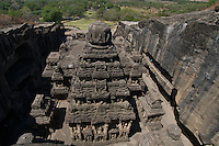 Kailash Temple at Ellora Caves Aurangabad, India.Kailash Temple, also Kailasa Temple is one of the 34 monasteries and temples, extending over more than 2 km, that were dug side by side in the wall of a high basalt cliff in the complex located at Ellora, Maharashtra, India. Of these 34 monasteries and temples, the Kailasa (cave 16) is a remarkable example of Indian rock-cut architecture on account of its striking proportion; elaborate workmanship architectural content and sculptural ornamentation.. It is designed to recall Mount Kailash, the abode of Lord Shiva[2]. While it exhibits typical Dravidian features, it was carved out of one single rock. It was built in the 8th century by the Rashtrakuta king Krishna I..The Kailash Temple is notable for its vertical excavation-carvers started at the top of the original rock, and excavated downward, exhuming the temple out of the existing rock. The traditional methods were rigidly followed by the master architect which could not have been achieved by excavating from the front. The architects found to design this temple were from the southern Pallava kingdom..
