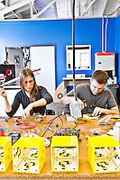 TechShop pictures: interior photography of  TechShop in San Francisco by San Francisco corporate architecture photographer Eric Millette Adam Ellsworth & crew of 8BitLit 8 bit lit assemble their lamps.
