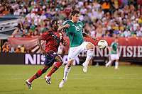 Hector Moreno (15) of Mexico plays the ball in front of Edson Buddle (9) of the United States. The men's national teams of the United States (USA) and Mexico (MEX) played to a 1-1 tie during an international friendly at Lincoln Financial Field in Philadelphia, PA, on August 10, 2011.