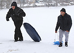 MIDDLEBURY CT. 11 December 2017-011718SV06-From left, Ochy Rivera and Arnold Rodriguez both of Waterbury head back up the hill after sledding in Fulton Park in Waterbury Wednesday.<br /> Steven Valenti Republican-American