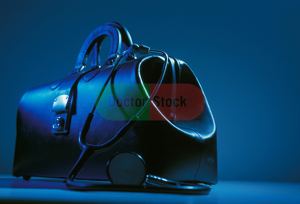 still-life of classic black leather doctor's bag with stethoscope draped over it, icons of healthcare